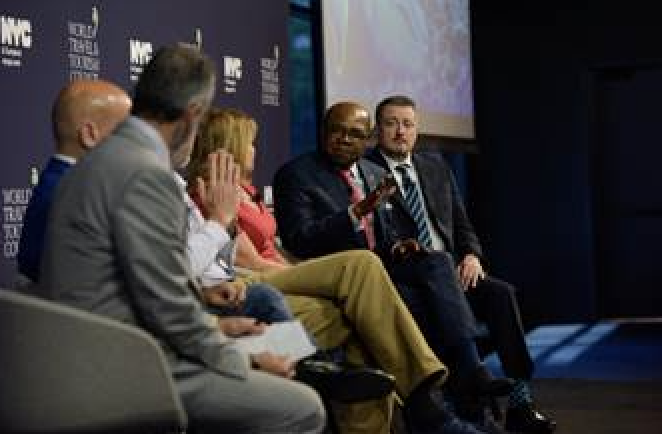 "Minister of Tourism, Honorable Edmund Bartlett ((2nd R), speaking on the 2019 World Travel and Tourism Council Panel, ""From Doing CSR to Being CSR,"" on June 11, 2019 in New York City."